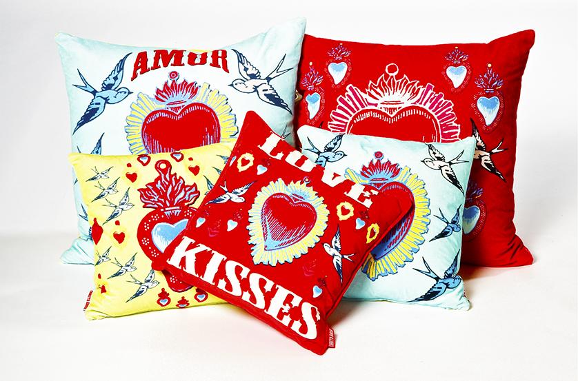 Vibrant Corita Rose cushions.