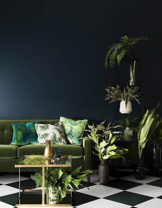 Dark walls need some foliage. Image Credit: Photo by Martina Gemmola / Styling by Ruth Welsby
