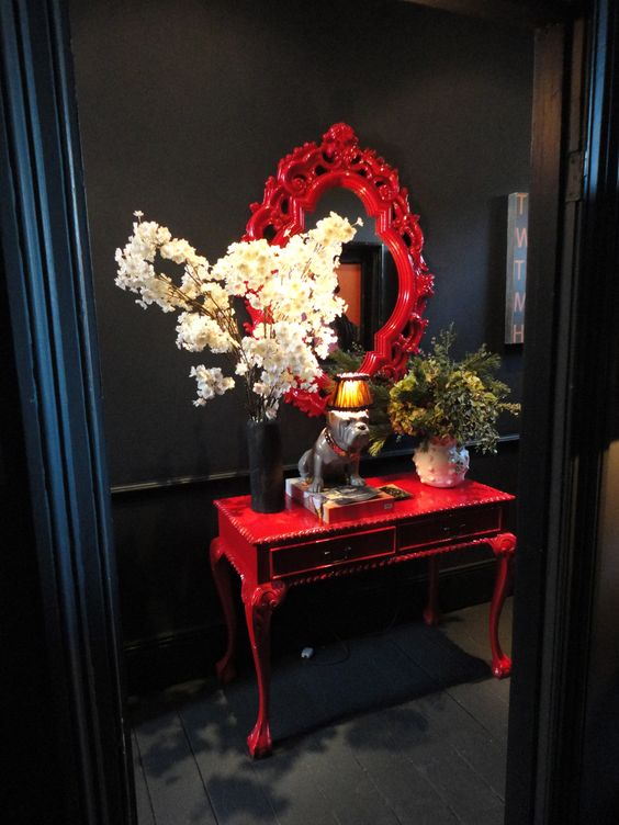 You can copy Abigail Ahern's Red console and mirror combo style with some gloss red paint.