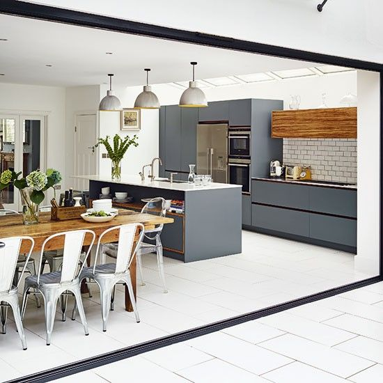An open-plan kitchen-diner like this one is a must for me!  Image Credit.
