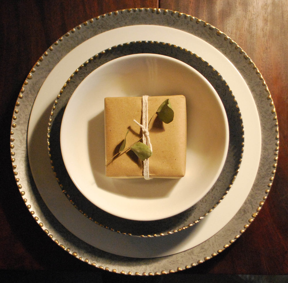 A place setting with small, beautifully wrapped gift for each guest always adds wow.