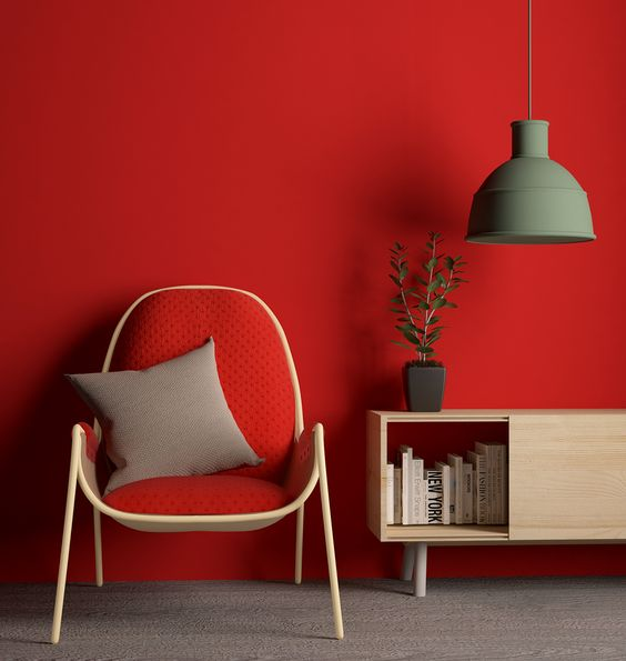 red wall and red chair