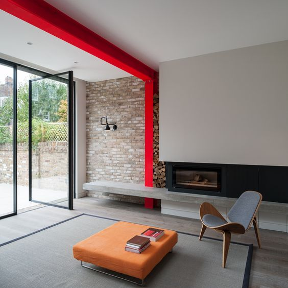 modern interior with red structural beam