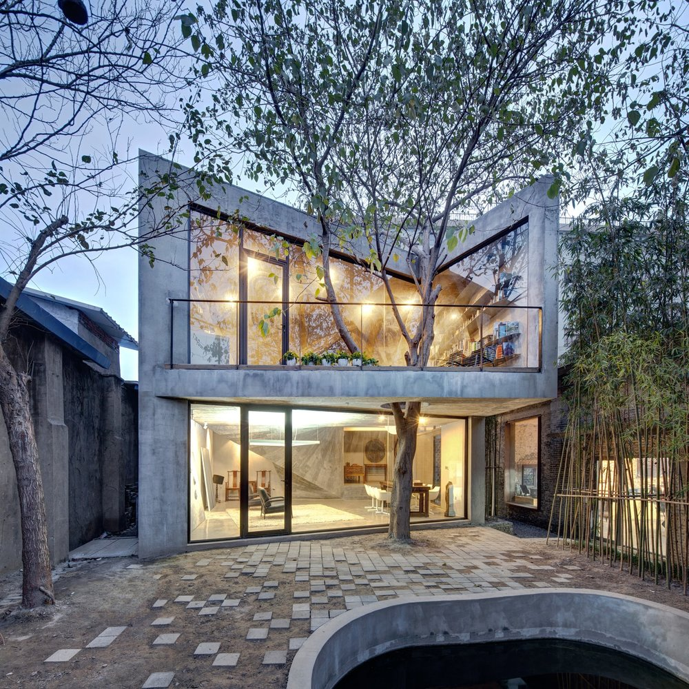 The Tea House, Shanghai. The Tea House, located in the backyard of Archi-Union's J-office, is constructed from the salvaged parts of the original warehouse's collapsed roof. The site was extremely constricted with walls on three sides, and was further restricted by a mature tree.