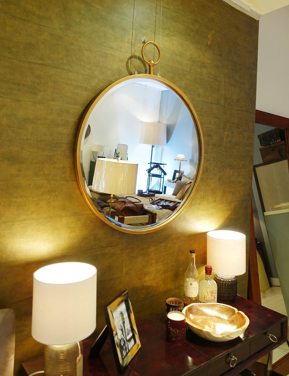 The  brass ring mirror ,  wooden copper bowls  make a bold statement.
