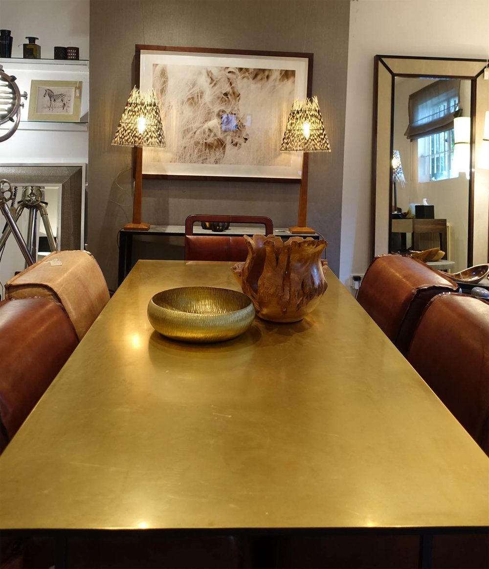 This is the stunning Brass dining table surrounded by handmade soft leather Club chairs.
