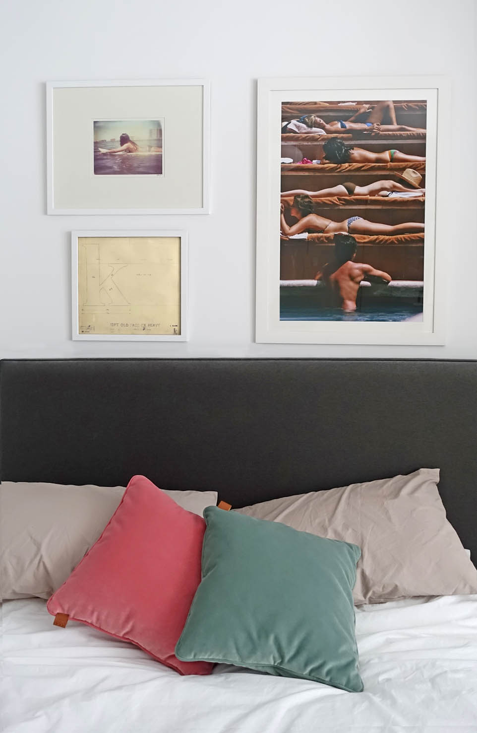 Some more beautifully framed prints hang above the bed.