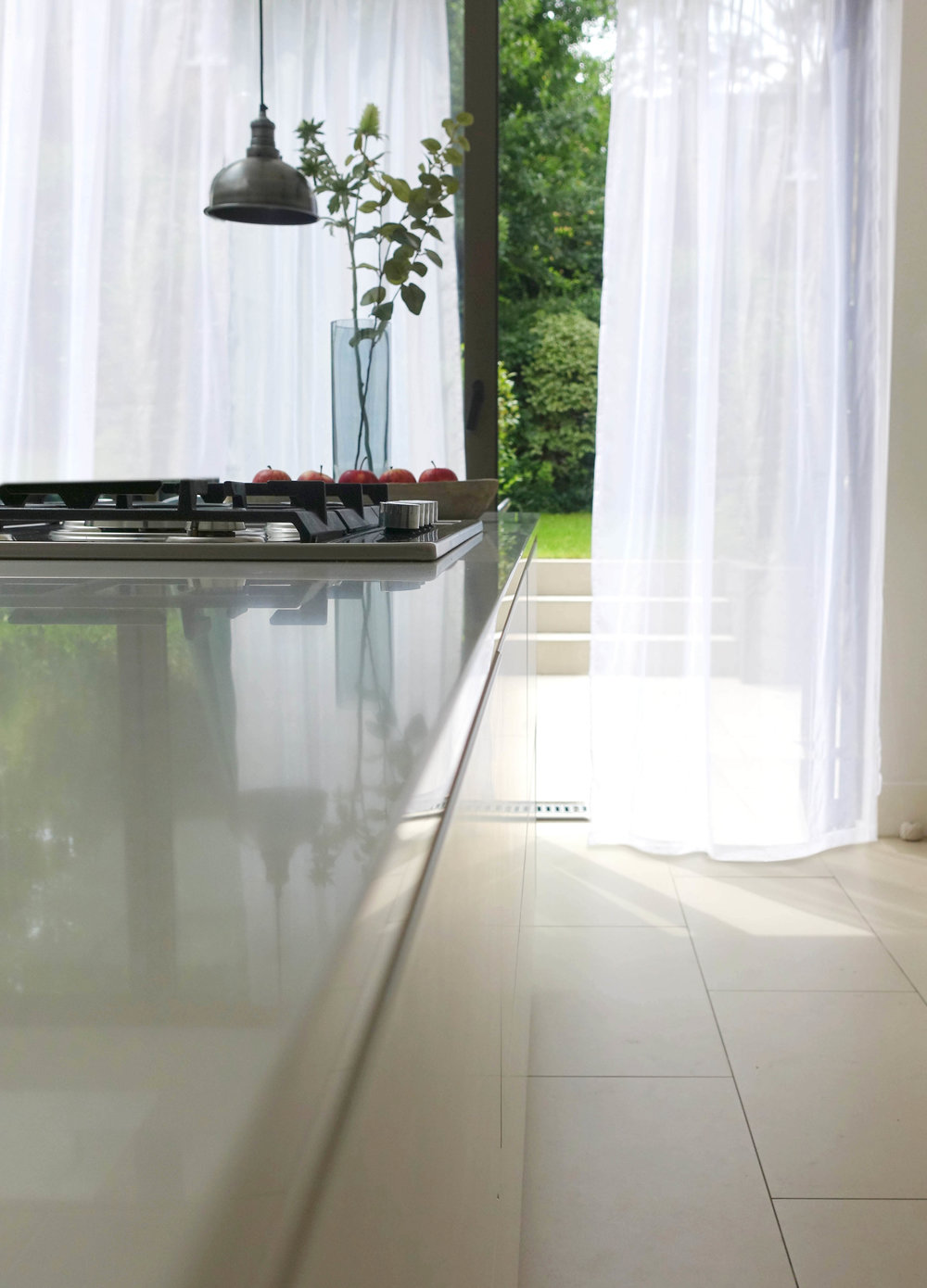 Floor-to-ceiling and wall-to-wall is best on large expanses of glass