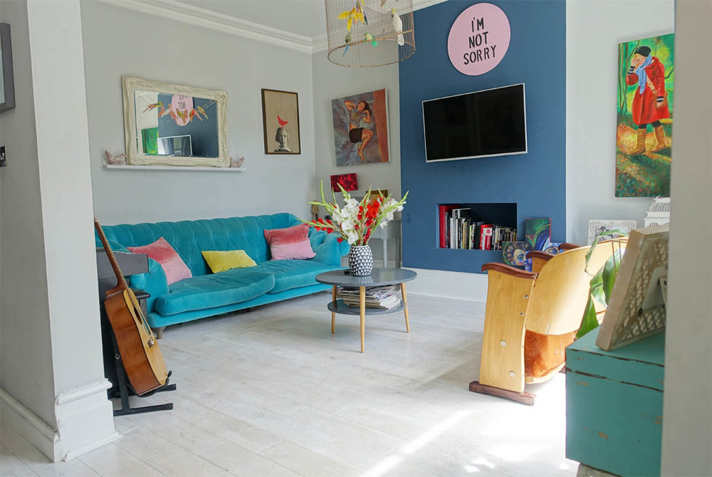 The colourful Living room. Vanessa matched Dulux paint colours to the more expensive varieties.