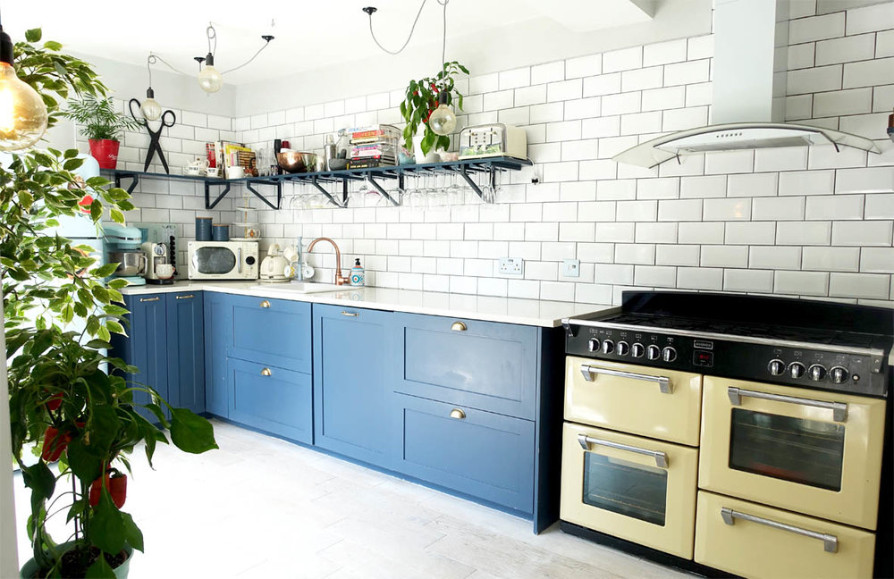 The bespoke cabinet doors and open shelving above are painted in Farrow & Ball's Stiffkey Blue.