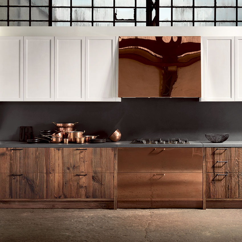 Rich wood textures, concrete and copper sit together beautifully in this kitchen by  Espresso kitchens . The wall cabinets have been painted white so that they recede into the white wall behind.