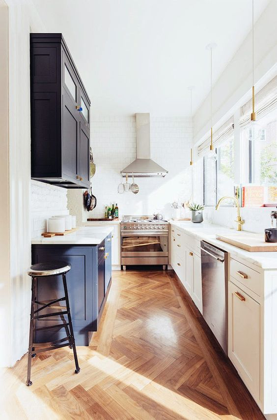 Wooden flooring always looks beautiful in a kitchen - large or small.