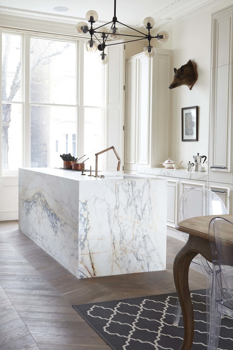 This kitchen with an attention grabbing island is by  Blakes London .