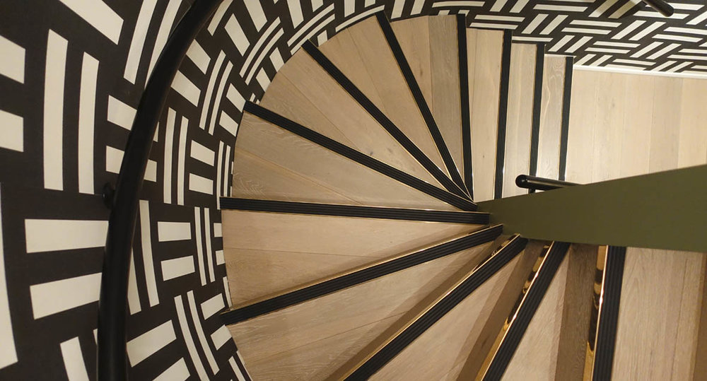 The bold staircase at Ella Di Rocca leads down to the spa and treatment rooms