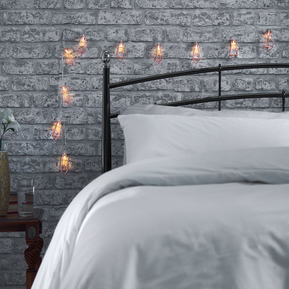 Gold Fairy lights add warmth to a bedroom