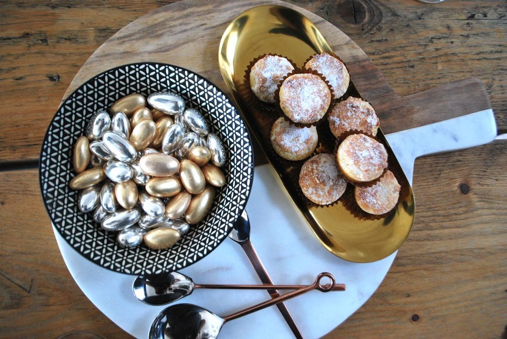 Sugared almonds and mini mince pies by Fortnum & Mason. Black and white bowl is from Tiger. Marble and wood board is by Habitat.