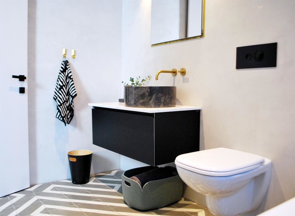 The wall-hung sanitary ware increases the feeling of space. Towel: Hay He Towel. Bin: Woodrow Waste Bin.