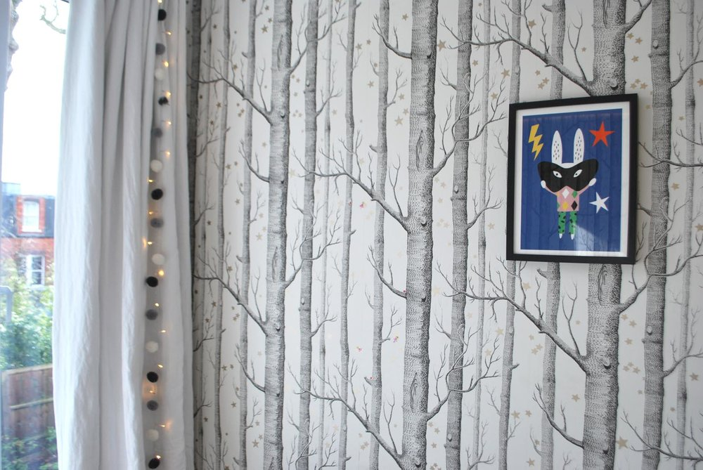 The  flax linen black-out curtains  are from West Elm. The quirky print was bought at Covent Garden Market.
