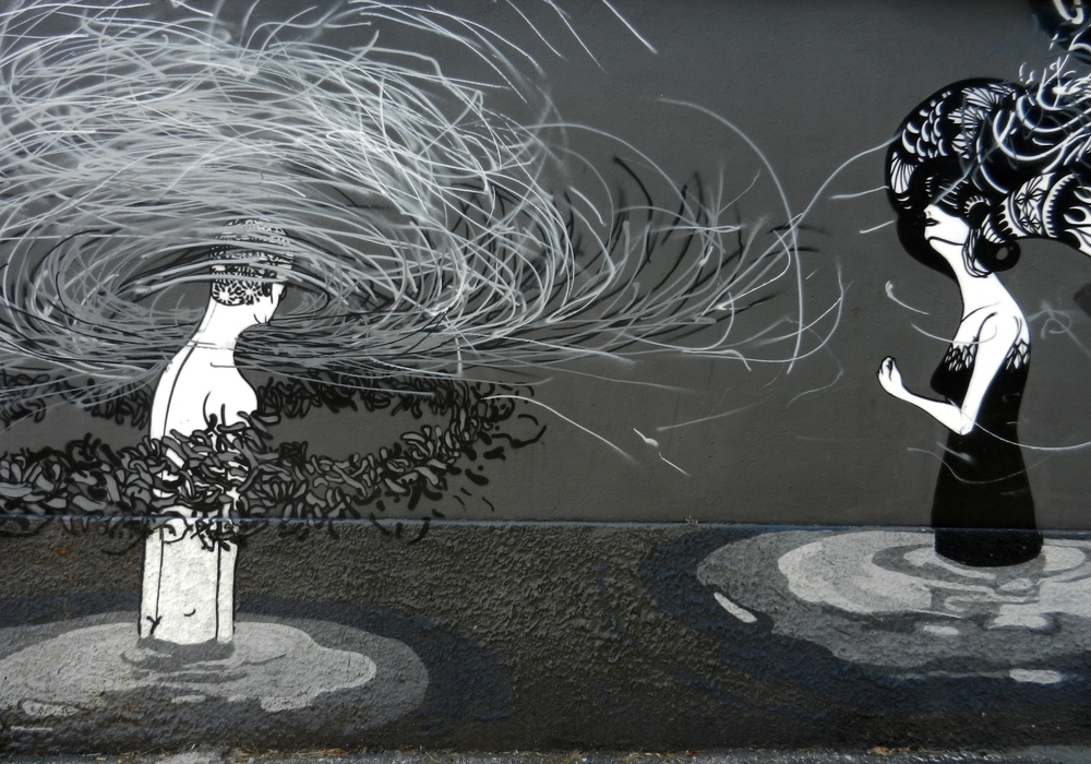 """From Roma Turismo: """"Mural by the Brazilian Herbert Baglione. The back background and white figures represent existence and death, order and chaos."""""""