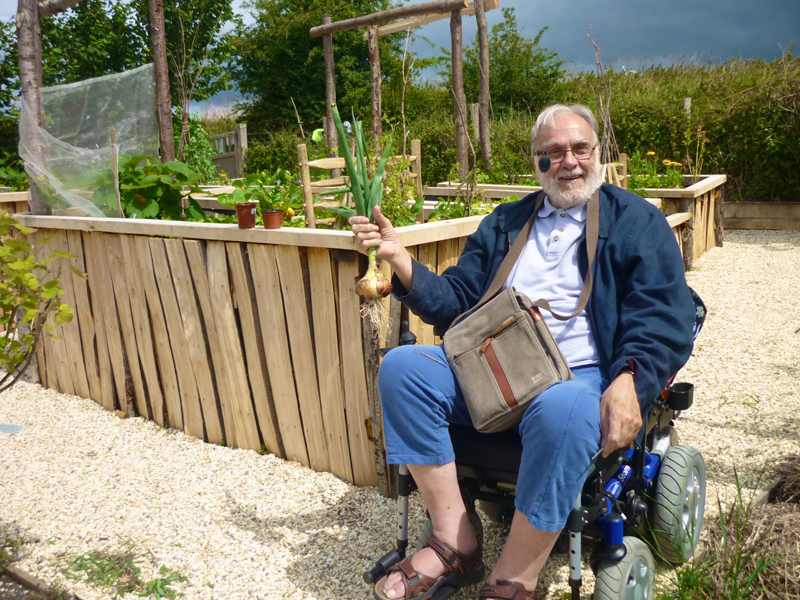 Man in wheelchair at allotment.jpg