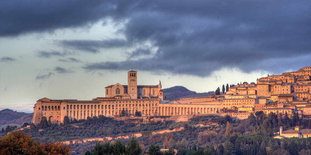 Assisi at sunset: this is one of the world's great pilgrim destinations and the birthplace of Santa Chiara and San Francisco.