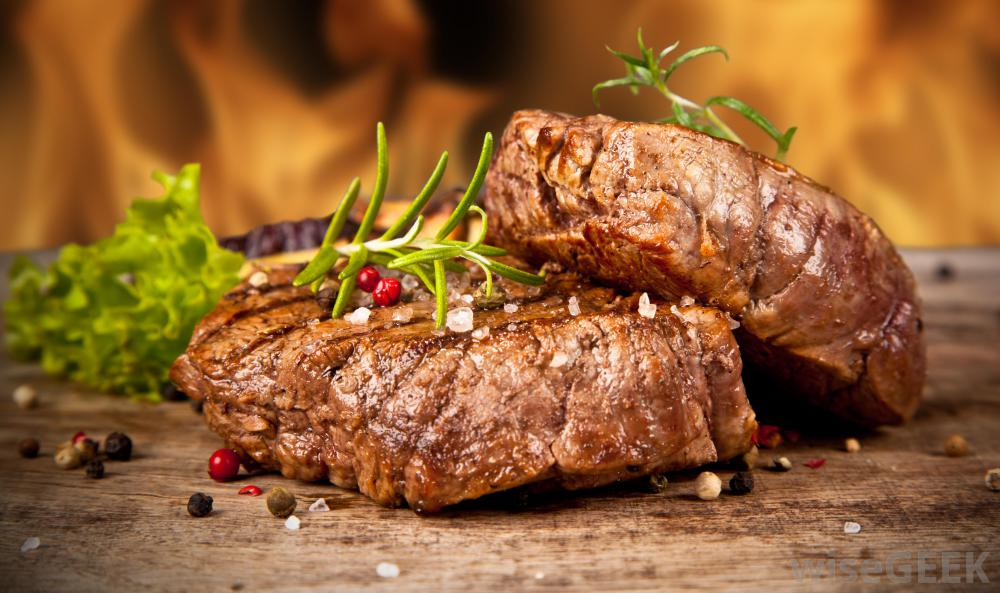 two-slices-of-beef-steak-near-fireplace.jpg