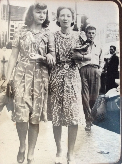 """This is a photo of my great-grandmother and grandmother, walking arm in arm down what we believe to be Central Avenue in Albuquerque. My great-grandmother moved to Albuquerque as a teen, and lived a simple (but profoundly important) life as a wife and mother, pouring into her two daughters. I'm fairly confident that she made the dresses that they are wearing. While I don't have many memories of her, my """"Nanny"""" was a woman who loved her family, and wanted the best for them. It was her influence upon my grandmother that went on to impact me."""