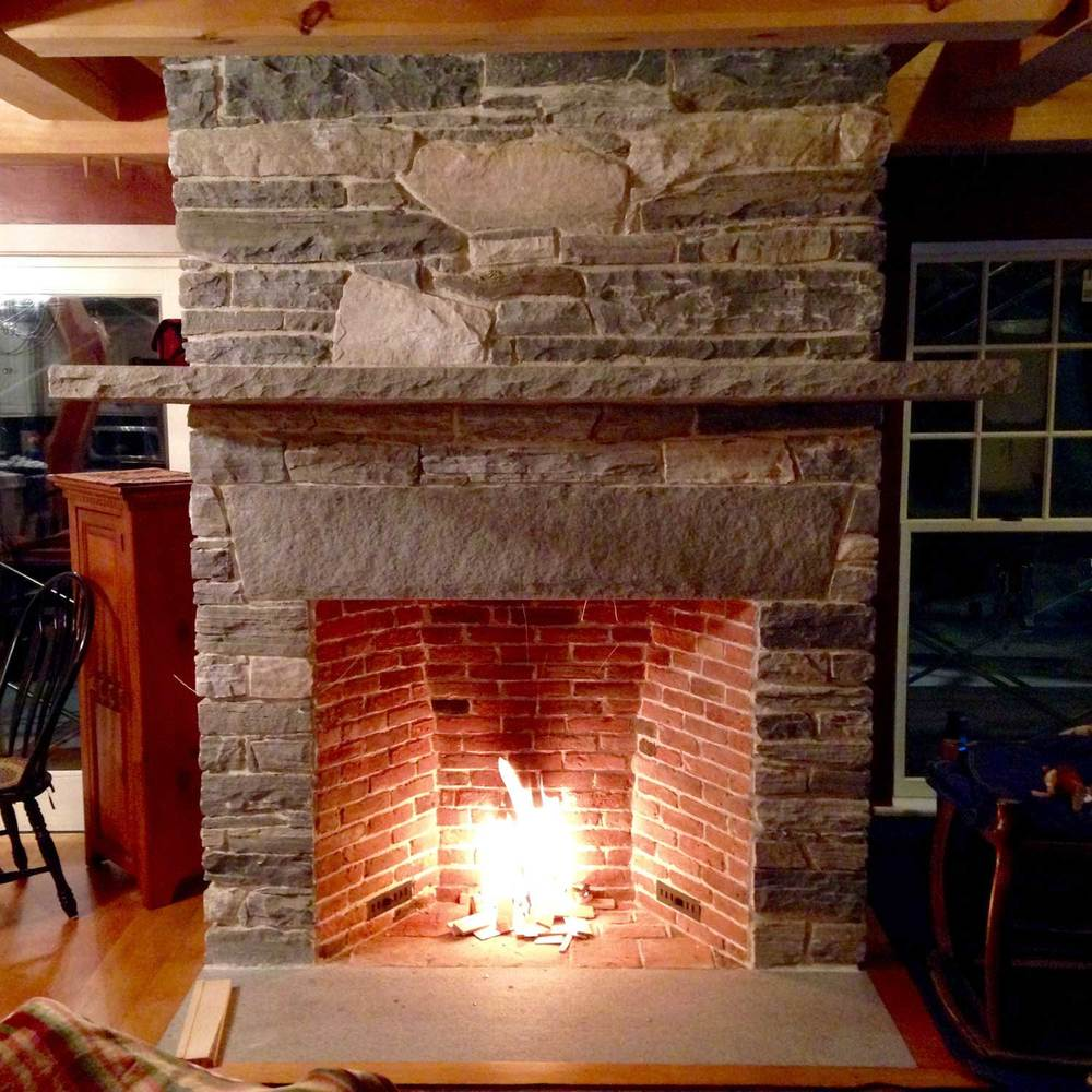 Fireplace using Stone and Brick from site - Berkshire Mountain Design Build, LLC