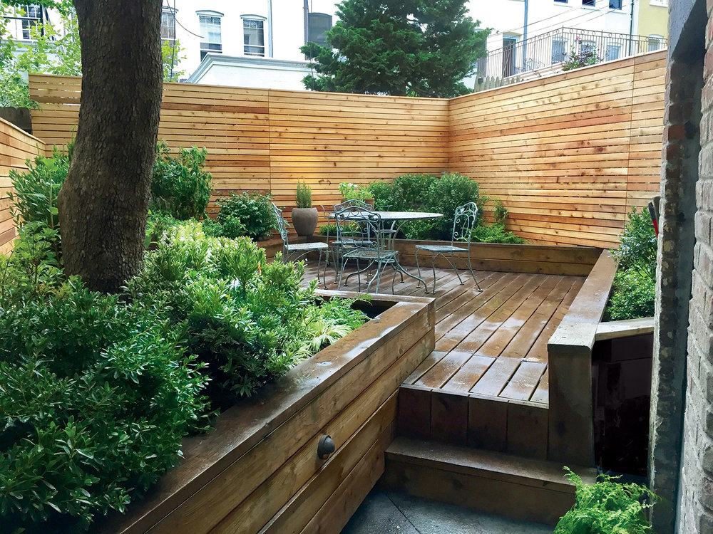 New York City gardens brooklyn backyard cedar fence blue stone pathway