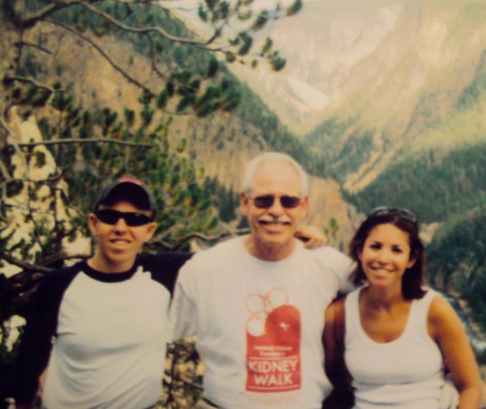"Michael: Vice President and Director of Strategic Partnerships for ALODF.  He is based in Pennsylvania.  ""This picture shows me, my sister, and my dad.  It was taken in 2007 in front of the Grand Canyon of Yellowstone National Park.  I love this picture because the trip was at a time when I needed a break from the realities of life.  Yellowstone is a true beauty and wonder of nature."""