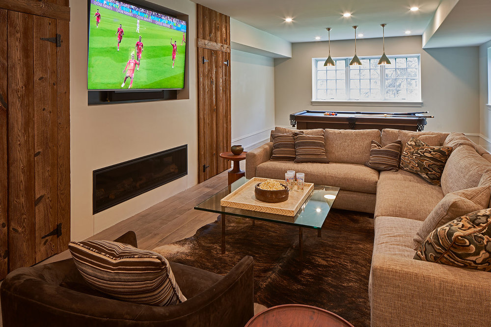 Basement big screen television, fireplace and pool table