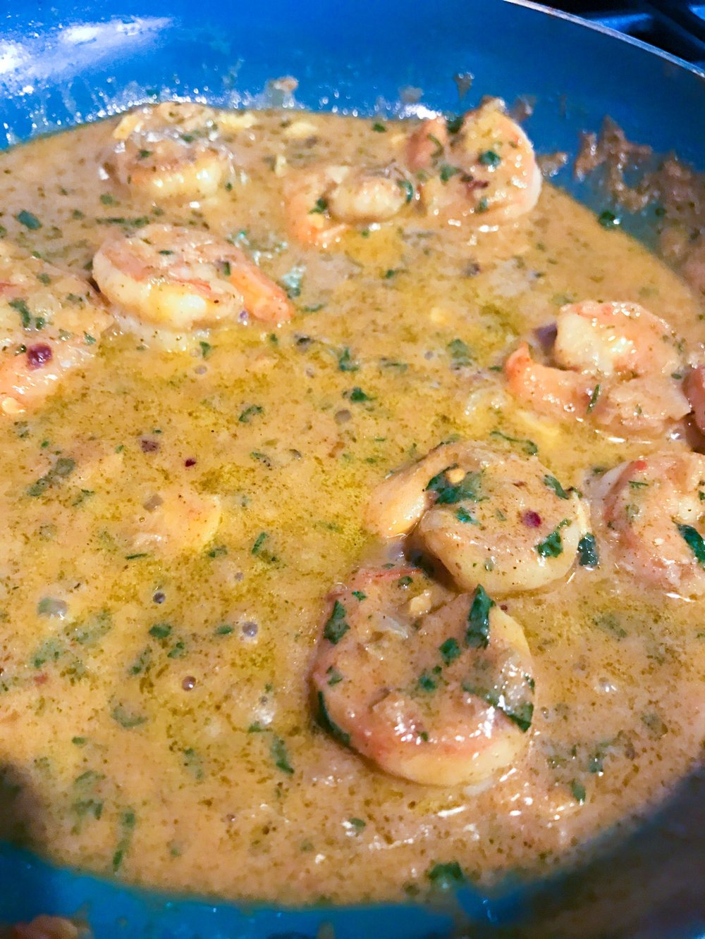 Shrimp simmering in sauce. Letting the sauce thicken. *Homer drools*