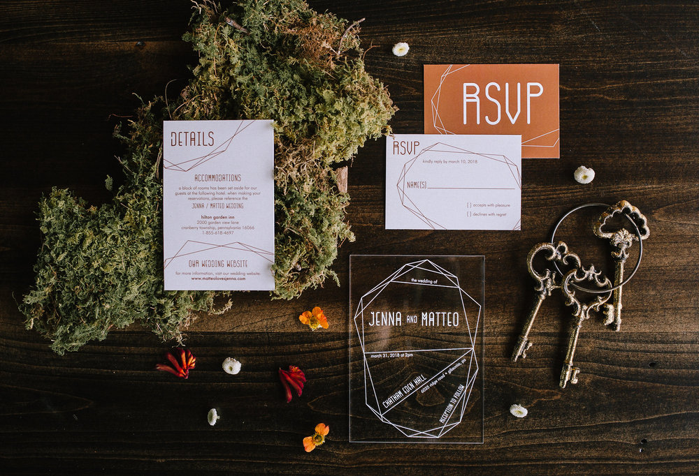 Purple Wagon Designs stationary set on vintage farm table with clear acrylic invites.