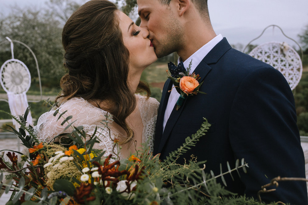 Bride & groom getting married at Chatham University Eden Hall. Flowers by Community Flower Shop. Divine Atlier Melissa gown is worn by bride and H&M navy suit is worn by the groom.