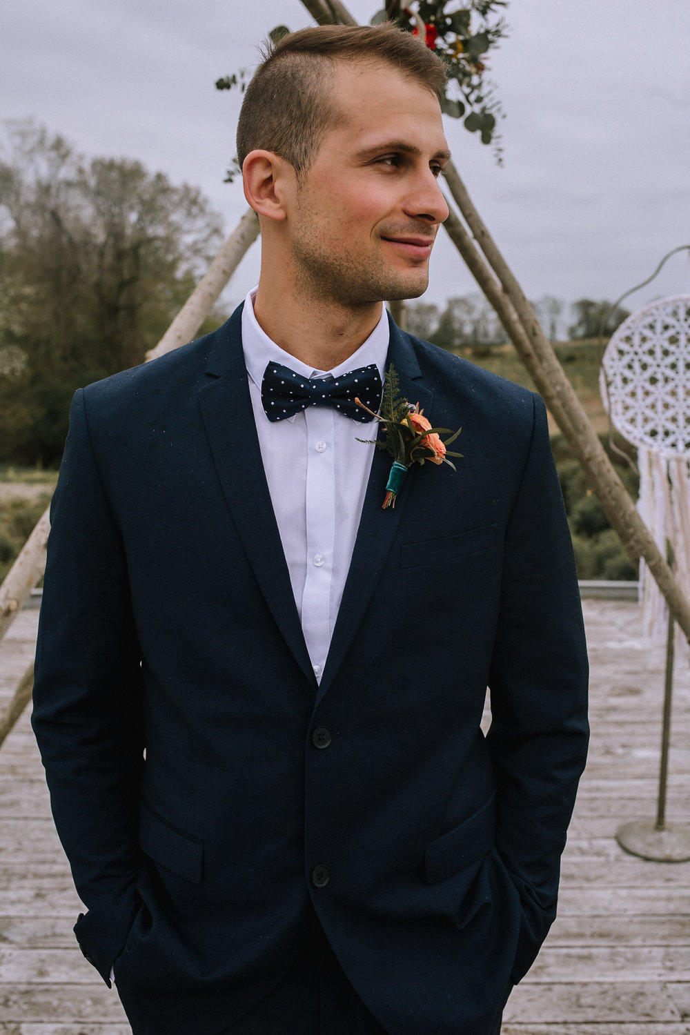 Groom's navy suit from H&M.