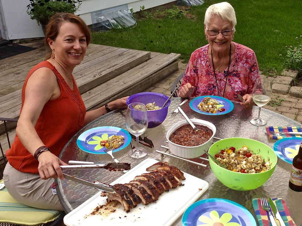 Backyard BBQ in Madison, WI: ribs, with baked beans and two salads. (That's my mom on the right)