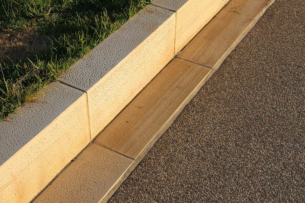 12-sandstone block kerb and gutter with exposed aggregate concrete.jpg