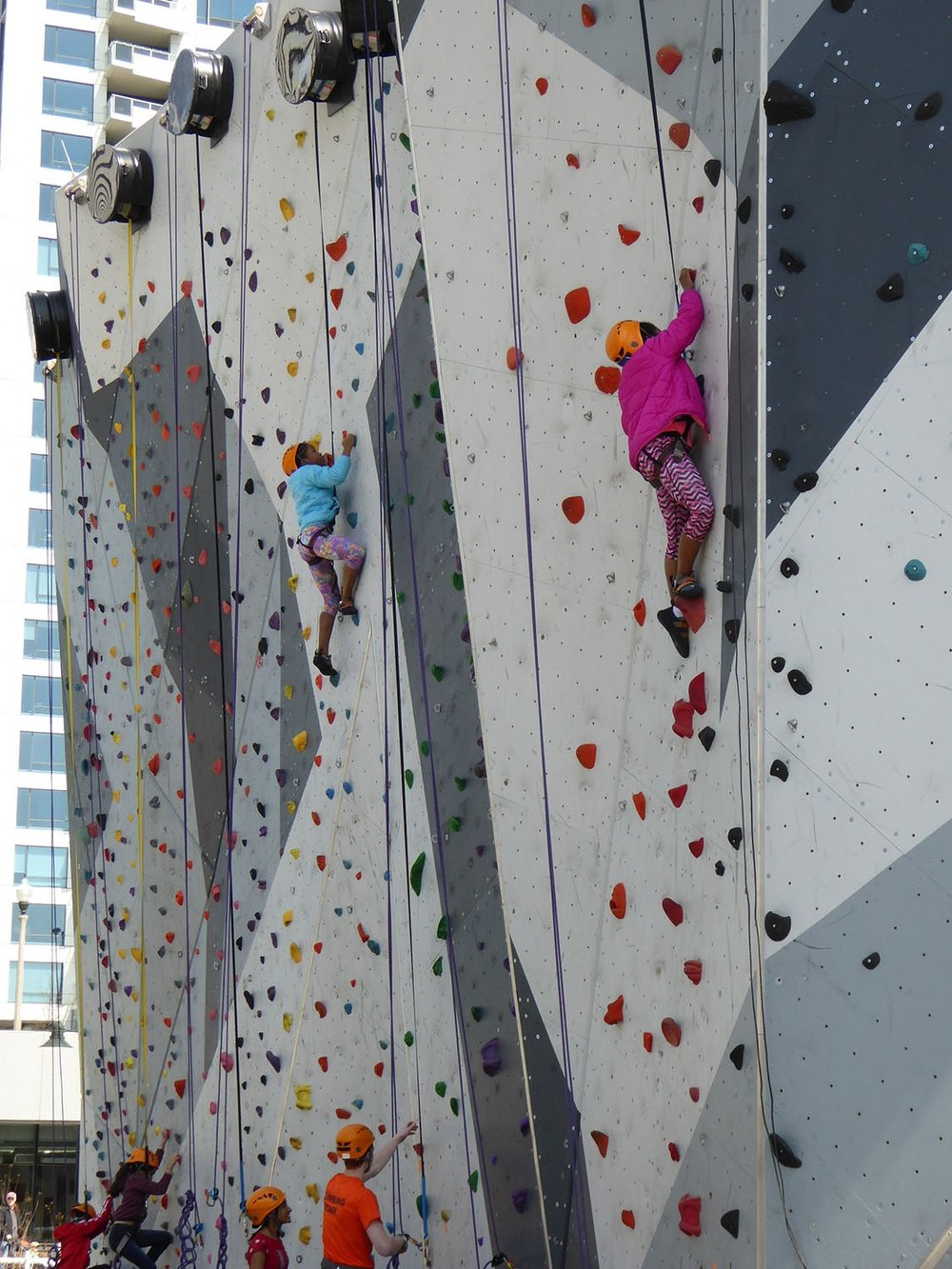 Children on rock climbing structure