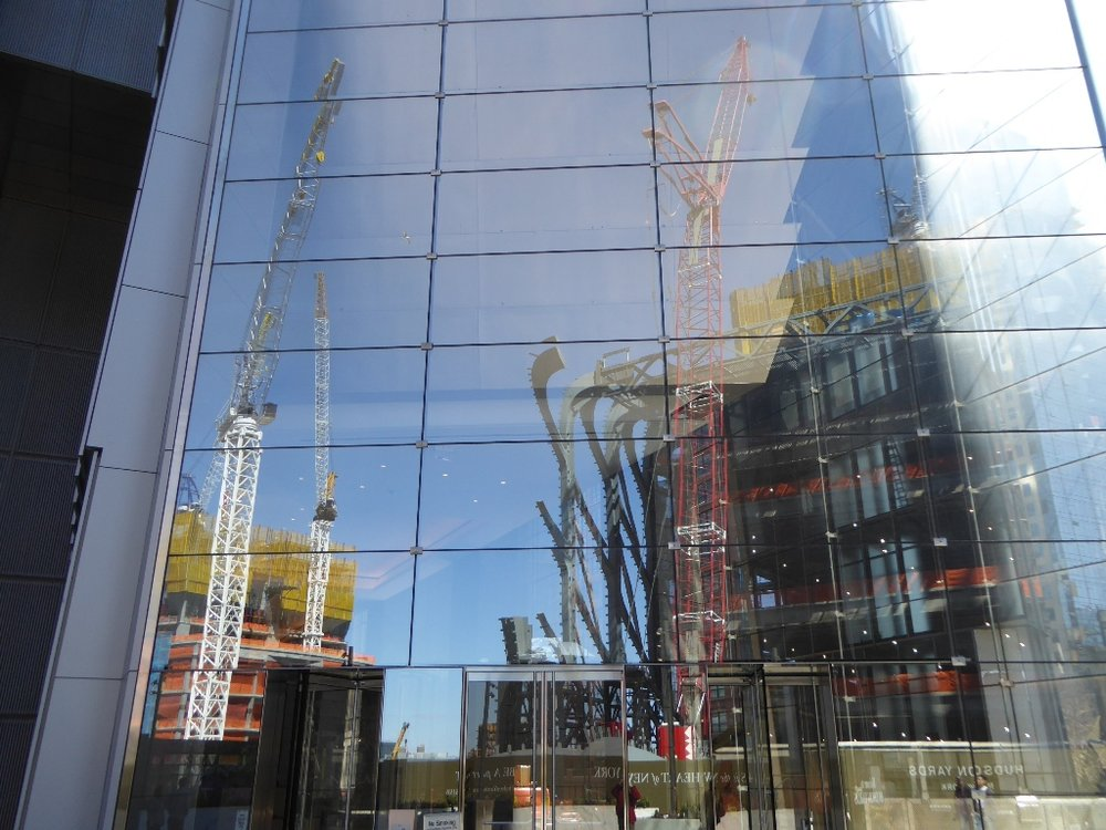 Reflection of The Culture Shed construction in existing building