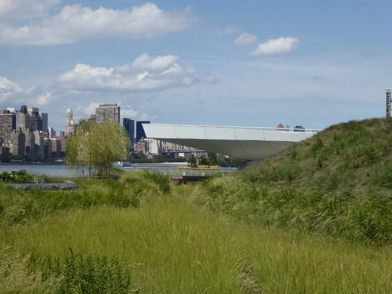 View across wetland & observation deck seen against Manhattan skyline