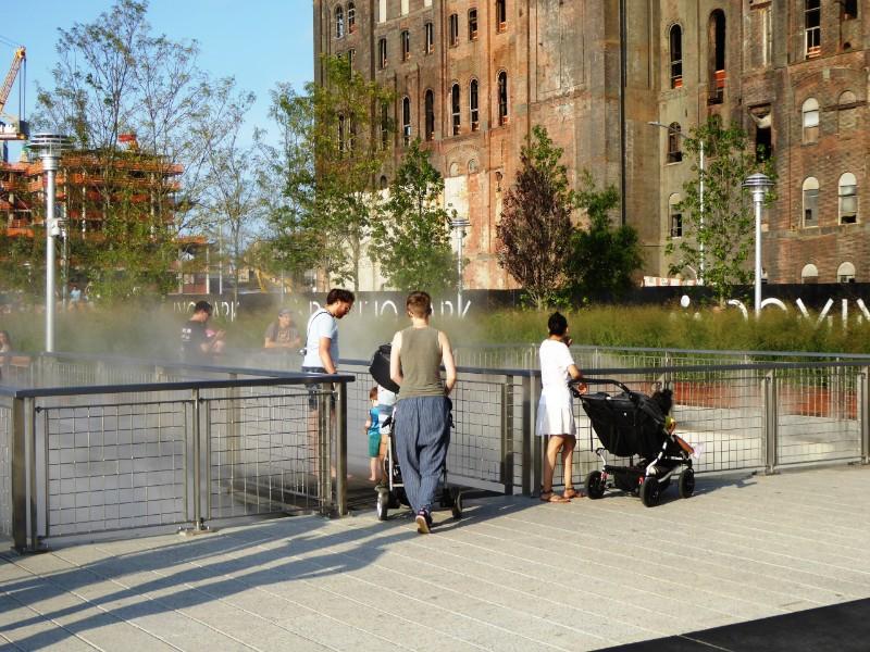 Mist rising through gaps in pedestrian deck