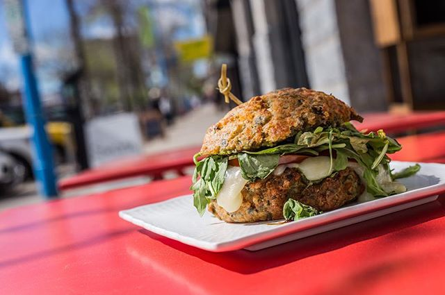 Enjoy that patio life with our Scone Slider made In-house on a baked Cheese & Chive Scone layered with pesto, fresh mozzarella, tomatoes, arugula spinach and finished with Balsamic drizzle. #YXE #cafe #dtnyxe #karma #community #vegetarian