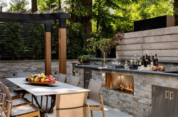 This full outdoor kitchen is complete with fireplace.