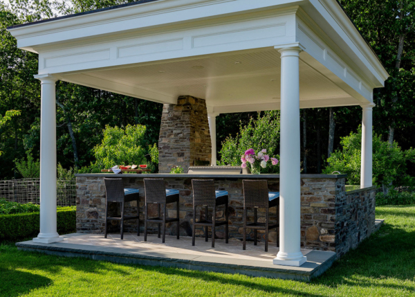 This Free-Standing, Covered Outdoor Kitchen is a destination in itself with a pizza oven and a full kitchen to create amazing meals by the pool.