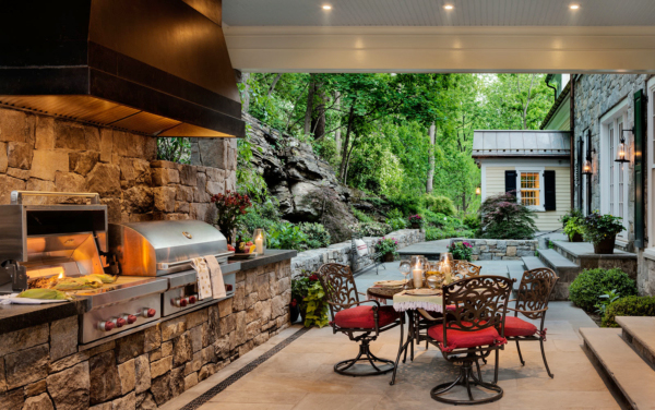 The outdoor kitchen is covered and not too far from the main kitchen.