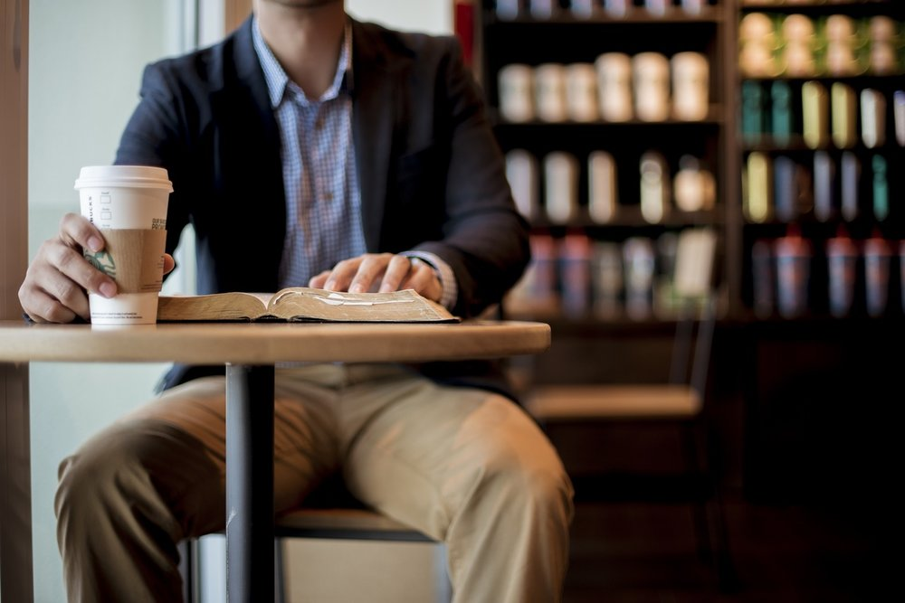 man evaluating his financial plan in a coffee shop