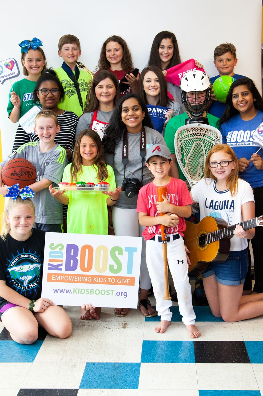 group kids booster pic with sign.jpg