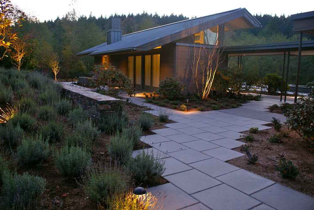 Landscaping flows between the main house and the guest house.  A terrace roof connects them together.