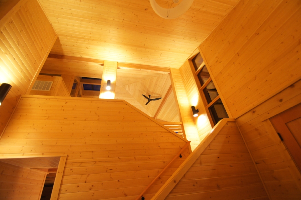 The stair climbs to the second floor loft and bedrooms.