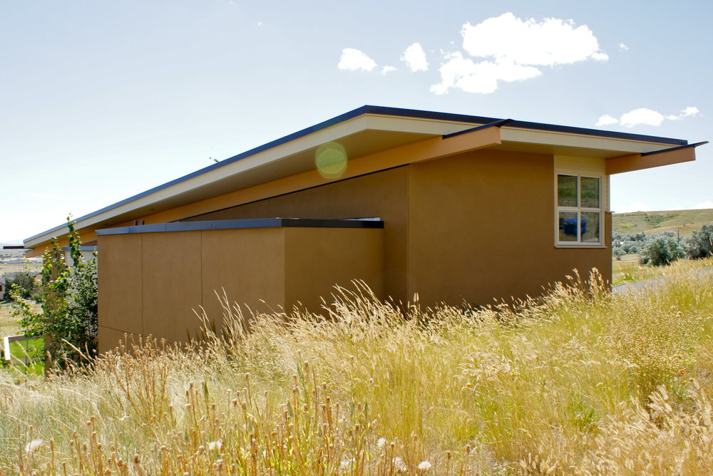 Colors of the home are intended to blend with the dry prairie grasslands while the forms provide a powerful presence.